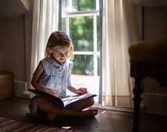 Quiet Time (dshoning) Tags: girl window reading light room floor