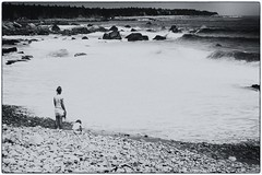 Watching the waves (halifaxlight (back in Nov)) Tags: canada novascotia whitepointbeach sea beach waves rocks woman child standing watching bw