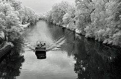Leisurely Evening Boat Ride on Erie Canal (infrared) (dr_marvel) Tags: pittsford ny newyork canal erie eriecanal water waterway infrared boat leisure wake waves reflections