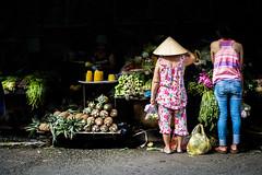 Saigon 040 (arsamie) Tags: saigon vietnam hochiminh asia seasia street market urban city life people everyday buy sell trade vegetables fruits ananas yellow pink dark light clairobscur nonla triangle conical hat back asian vietnamese saigoneer tan dinh