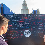 Soccer fans writing messages on black board at fan fest thumbnail