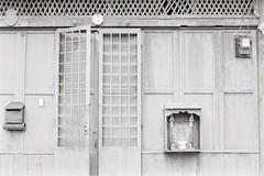 opened and closed (chong-yen) Tags: konicatcx berggerpancro400 analog blackandwhite melaka
