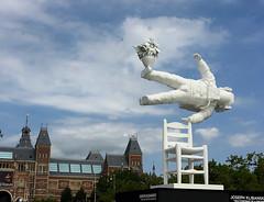 Self -Portrait of a Dreamer, Amsterdam (angela allen writes) Tags: amsterdam klibansky dreamer sculpture rijkmuseum water sky flying chair portrait