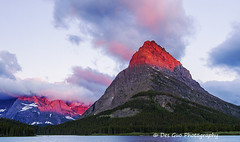 Mount Grinnell at Sunrise, Glacier National Park (PhotoDG) Tags: swiftcurrentlake glaciernationalpark montana lake mountgrinnell peak glow sun cloud landscape color wideangle nationalpark rockymountains therockies mountain glacier manyglaciers nature ef1635mmf28liiusm manyglacierhotel manyglacier 冰川国家公园