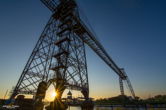 Sunrise at Newport Transporter Bridge. (andyp178) Tags: transporter bridge sunrise sunburst summer riverusk architecture newport wales sillouhette iron steel nikon tokina river crossing gondala