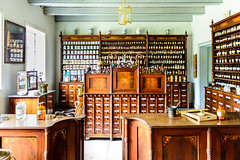 The Old Pharmacy (Exploring northern Greece for a week) Tags: openair museum molfsee statemuseumofethnology freilichtmuseummolfsee bottles shop counter pharmacy