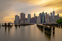 Sunset over Manhattan (Norbert Stening) Tags: brooklynheights amerika yellow water brooklynbridgepark brooklynbridge newyork manhattan sunset