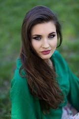 Relax in a park (piotr_szymanek) Tags: marcelina marcelinab woman young skinny face portrait outdoor eyesoncamera longhair closeup green blouse grass park 1k 20f 50f 5k 100f 10k 20k 30k
