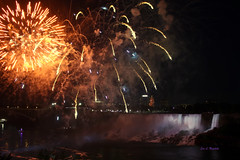 Falls Night Lights (Jan Nagalski) Tags: fireworks skyrocket burst starburst waterfall falls niagarafalls americanfalls ontario canada night nightlight lights dark spotlight river niagarariver newyork usa summer jannagalski jannagal