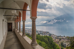 Madonna del Sasso (Andrea Gambadoro) Tags: yellow sanctuary switzerland hdr high dynamic range view church photography photographer sacre sky clouds finger rays lake maggiore arches corridor city cityscape seascape lakescape