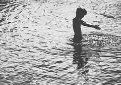 catching the light (Pea Jay How) Tags: akerbrygge sunlight sun summer oslo bw blackandwhite monochrome mono splashing splash swim boy children child playing play light water
