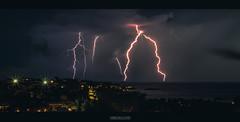 ride the lighnings (HarrisGkioulistanis) Tags: lightning storm tropical rain athens greece flash clouds sky sea water ocean