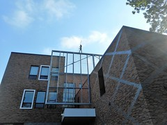Fun Funambulist (navejo) Tags: montreal quebec canada barclayschool parkex funambulist art sculpture wall brick metal