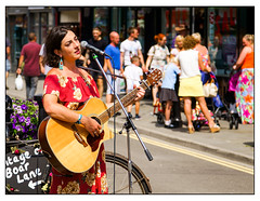 Woman with guitar (Photos And All That) Tags: woman guitar musician music singer busker streetphotography street sonyalpha7mark3 sony sonyilce7m3 sonyalpha ilce7m3