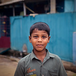 Portrait of Indian boy on the street in fishing village thumbnail
