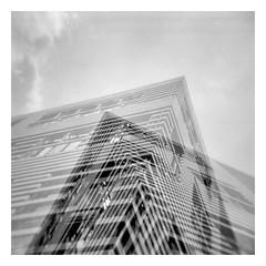 which direction? (Armin Fuchs) Tags: arminfuchs analog film holga würzburg petrinihaus diagonal doppelbelichtung doubleexposure clouds sky ilfordfp4125 120mm mediumformat stripes superposition urban house scan square