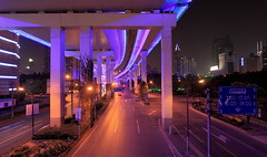 Mezzanine City (Eye of Brice Retailleau) Tags: architecture buildings china city cityscape ciudad composition light outdoor panorama road skyline skyscraper travel urban ville vista asia asie chine shanghai street bypass colour colours colourful purple violet night nightime citylights lights nightscape