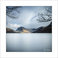 Interlude XIII (Frank Hoogeboom) Tags: unitedkingdom uk lakedistrict buttermere water lakes england britain square color fineart longexposure trees branches mountains hills landscape waterscape british english travel outdoor nature scenic