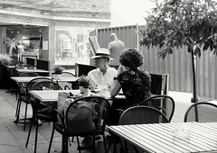 What we've got here is failure to communicate.  Cool Hand Luke. (ianmiller6771) Tags: streetphotography streetphotographyuk bw blackandwhite monochrome communication marriage moustache boredcouple fuji whiteblack 35mm coffeehouse