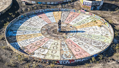 Wheel of Misfortune (magnetic_red) Tags: wheel game misfortune sign graffiti desert abandoned mine despair faded ruins
