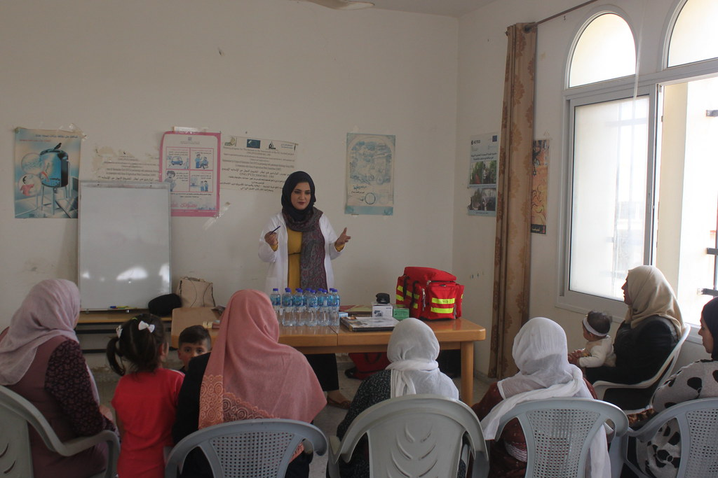 The Nurse explaining to women in Qalqiliya the various forms of contraceptives. photo credit- Omar A. Caption