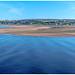 Across the water (Peter Leigh50) Tags: sea seascape seaside beach estuary tweed river sand people walking town landscape water blue fujifilm fuji xt2 landschaft