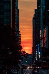Layers of Manhattanhenge (DerekSteen) Tags: 42ndstreet grandcentralstation manhattan manhattanhenge manhattanhenge2018 nyc newyorkcity buildings clouds skyscraper streetscape sunset telephoto newyork unitedstates us