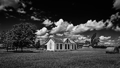 An Old Homestead (Mike Schaffner) Tags: abandoned bw barn blackwhite blackandwhite clouds decay decayed derelict deserted dilapidated farm field hay homestead house monochrome old ranch ruins sky