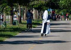 Traction and a habit. (Nance Fleming) Tags: july2018 nun skate rollerblade toronto leisure exercise fitness park trees relax habit traverse traction summer heat robes