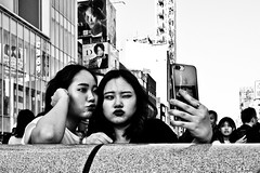 Duckfaced..... (Victor Borst) Tags: street streetlife streetphotography reallife real realpeople asia asian asians faces face candid travel travelling trip traveling urban urbanroots urbanjungle blackandwhite bw mono monotone monochrome duckface duckfaced duckfaces selfie selfies selfiestick osaka mankind japan japanese smartphone city cityscape citylife xpro2 expression sexy fuji fujifilm fun hot dōtonbori dotonbori
