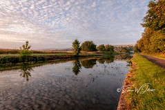 _DSC.0075 - Straight Mile, Burnley (SWJuk) Tags: swjuk uk unitedkingdom gb britain england lancashire burnley home canal leedsliverpoolcanal straightmile dawn sunrise daybreak bluesky clouds light sunlight towpath footpath trail vanishingpoint trees 2018 aug2018 summer nikon d90 nikond90 tokina1116mm wideangle rawnef lightroomclassiccc water calm flat reflections sky skies