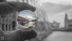 Circumnavigate this......... (alundisleyimages@gmail.com) Tags: lensball crystalball art albertdock liverpool merseyside aroundtheworldyachtrace clippers reflection boats yachts selectivecolour monochrome hand fingers ports harbours maritime docks sailing masts sport event nikon photography