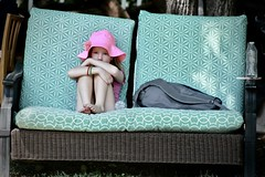 lonely girl (eva michie) Tags: baby girl child lonely sad depressed lost scared worried nervous portrait cool interesting different awesome blue couch hat pink sun grass august summer photography digital camera