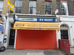 EZ Mart, Grafton Way. 20180822T16-43-44Z (fitzrovialitter) Tags: shuttered shop abandoned peterfoster fitzrovialitter city camden westminster streets rubbish litter dumping flytipping trash garbage urban street environment london fitzrovia streetphotography documentary authenticstreet reportage photojournalism editorial captureone olympusem1markii mzuiko 1240mmpro microfourthirds mft m43 μ43 μft geotagged oitrack exiftool linearresponse