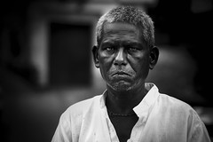 The Seller (Arun_kumaran) Tags: india people portrait professional blackandwhite monochrome indoor blackbackground peopleinphoto life sunlightlightplay field culture village urban westbengal streetphotography kolkata chicsnap artspeakbetter akr odisha orissa temple city oldcity