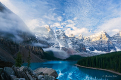 Rolling fog (grahamvphoto) Tags: mountain lake sky clouds fog foggy water trees landscape snow tree canada morainelake alberta banff reflection travel sunrise rocks nature natural earth