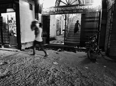 Decisive (Shahrear94) Tags: street photography streetphotography bnw blackandwhite blackwhite black bangladesh dark shadow no sharpness note4x night monochrome monochromatic moment decisive human dhaka run urban children blur juxtaposition flicker