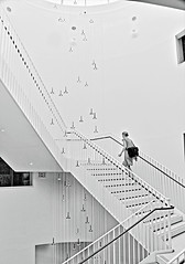 THE LIGHT AT THE TOP OF THE STAIRS (panache2620) Tags: monochrome stairway woman climb climbing atrium universityofminnesota minneapolis minnesota eos canon art fineart creative