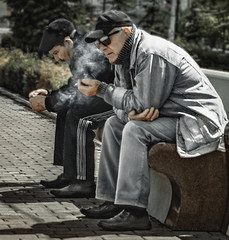 in deep thought  ... to be or not to be ... (altazet) Tags: altazet sakhalin anatolyleonov streetphoto candid guys man smoke fume tobeornottobe thought