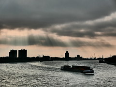 Sun Power (louise peters) Tags: sunrays zonnestralen clouds wolken wolkenlucht sky river rivier maas neuwemaas meuse port haven rotterdam carrier boat vrachtschip vrachtboot schip ship silhouettes skyline horizon weather weer