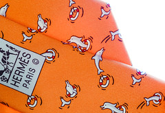 Hermes Frolicking Dolphins (hilarybachelder) Tags: hermes paris dolphins luxury ties silk orange necktie fashion designer parisian france french style color macro a7rii sony 90mm soie