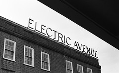 We gonna rock down to Electric Avenue (benjaminjohnson1983) Tags: 2018 blackwhite brixton electricavenue film ilforddelta400 london londonvisit2018may monotone olympusom1md sign toshare typography