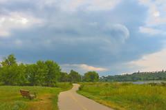 Fish Creek Park (Jane Olsen) Tags: bench river water landscape calgary fishcreekpark clouds park