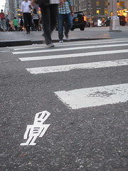 Tall Pointy Head White Robot Tile Stikman 7778 (Brechtbug) Tags: a return stikensian times tall pointy head white robot tile stikman nyc street art graffiti tag tagging stencil cut out toynbee stickman asphalt figurative school flat action figures new york city 08152018 cross walk smoke 2018 stik man men curious streets summer heat august 48th 6th ave