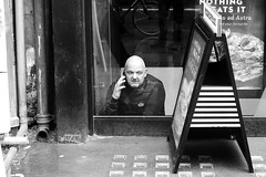 """""""They said it was a ground floor opportunity...."""" (markwilkins64) Tags: markwilkins portrait vboard drainpipe monochrome mono blackandwhite candid streetphotography street strand thestrand london"""