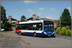 36211, High Stack. (Jason 87030) Tags: enviro e200 d4 daventry northants northamptonshire longbuckby highstack wheels stagecoach midlands red white blue orange canon eos 20d test experiment houses roadside shot shoot uk sky weather light 2018 trees garden lamppost village scene