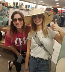 Sisters posing (BarryFackler) Tags: ashley katie girls teens tennagers women wahine kohlsdepartmentstore kohls smiling smiles posing hammy sunglasses indoor hat thumbsup omaha omahanebraska omahane family 2018 nebraska midwest vacation barronfackler barryfackler