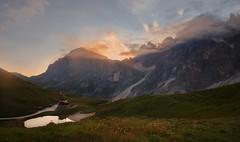 What a sunrise! (Alessio Bertolone) Tags: dolomiti unesco mountains montagne alba sunrise nuvole clouds alessiobertolone nikon nikond7000 pond laghetto baitasegantini prati meadows