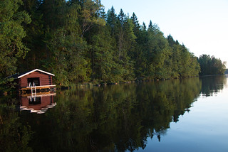 The Beauty of Finnish Summer - Sunset reflections on lake surface