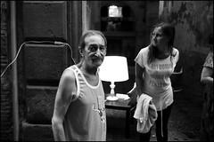 (Gli Uomini Vanno Presi Per La Gola) (Robbie McIntosh) Tags: leicam9p leica m9p rangefinder streetphotography 35mm leicam summilux leicasummilux35mmf14i summilux35mmf14i autaut summilux35mmf14preasph man strangers napoli spanishquarters processionemadonnadelcarmine procession religion cigarette eyecontact lamp